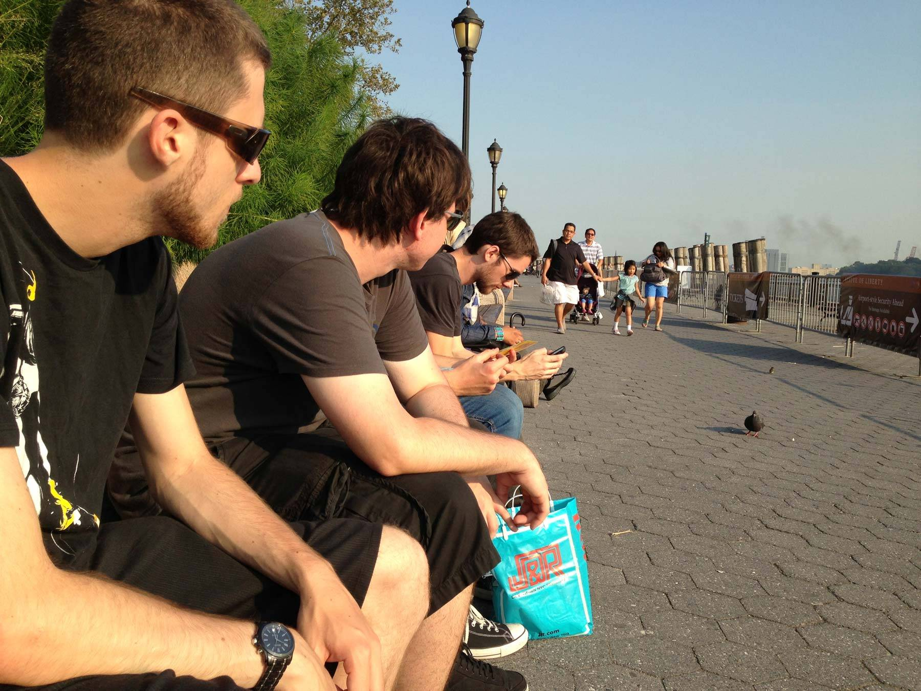 Irwin, Andrew, Butcher, and Jared sitting at the bay