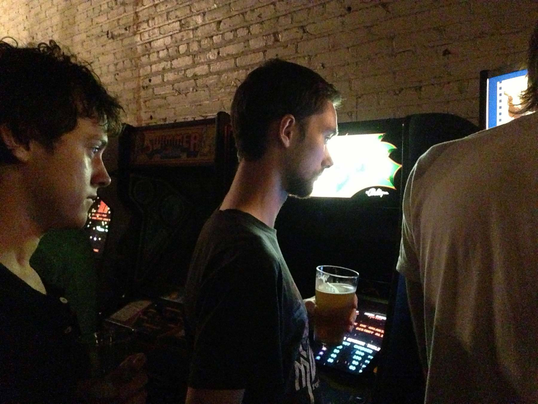 Richard and Jared watch Butcher play an arcade game