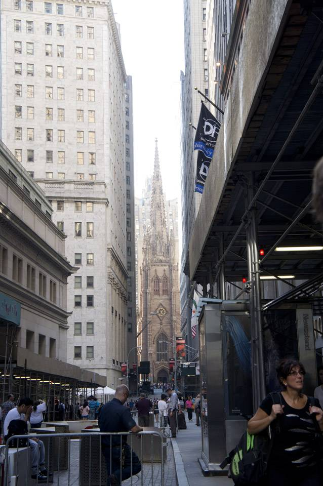Church flanked by tall buildings